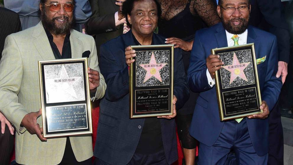 Songwriters Eddie Holland (L), Lamont Dozier (C) and Brian Holland (R) pose during their Hollywood Walk of Fame Star ceremony
