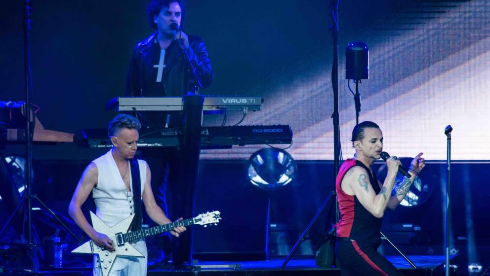 BERLIN, GERMANY - JULY 23: (L-R) Martin Gore, Peter Gordeno and Dave Gahan of Depeche Mode perform live on stage during a con