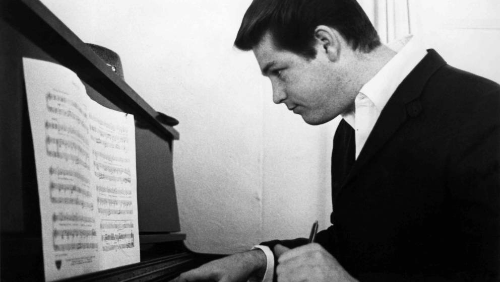 LOS ANGELES - 1964:  Musician Brian Wilson of the rock and roll band 'The Beach Boys' works on a composition on an upright pi