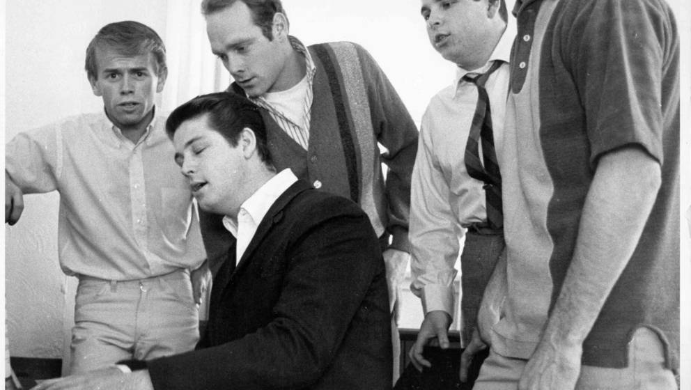 1964:  Al Jardine, Brian Wilson, Mike Love, Carl Wilson and Dennis Wilson of the rock and roll band 'The Beach Boys' sing aro