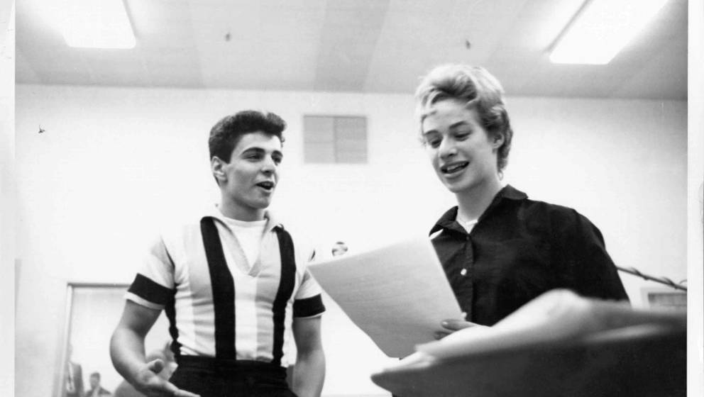 NEW YORK, NY - CIRCA 1959:  Songwriter Carole King and singer Johnny Restivo chat between takes in a recording studio in New