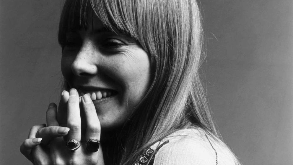20th November 1968:  Headshot portrait of American musician Joni Mitchell smiling with her hands over her mouth.  This image