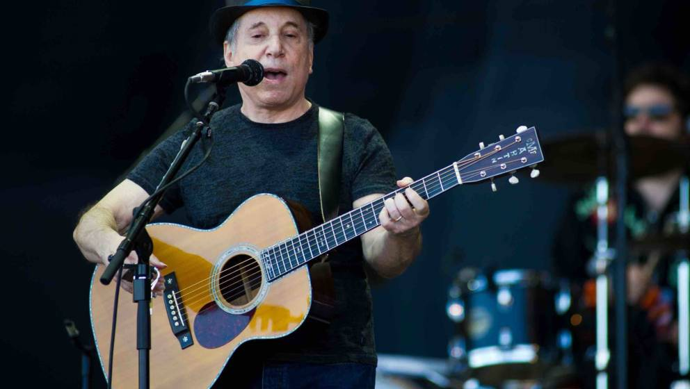 GLASTONBURY, ENGLAND - JUNE 26: Paul Simon performs live on the pyramid stage during the Glastonbury Festival at Worthy Farm,