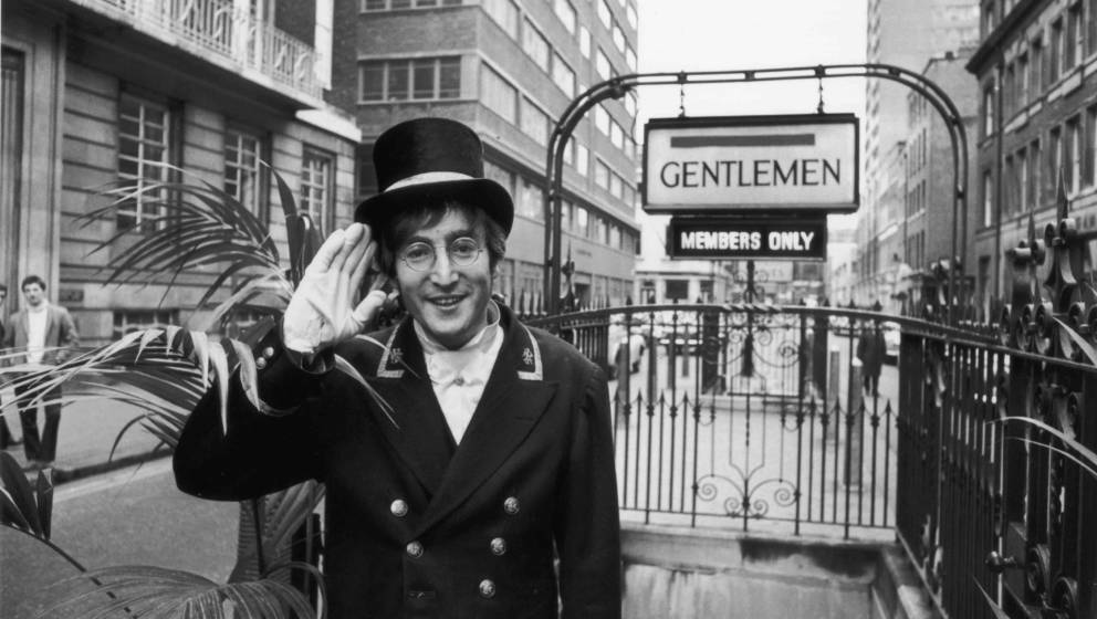 27th November 1966:  British rock musician and member of The Beatles John Lennon (1940 - 1980), dressed as a Public Lavatory