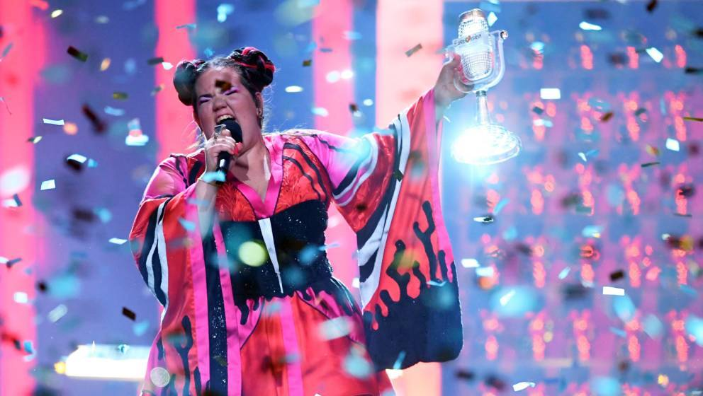 TOPSHOT - Israel's singer Netta Barzilai aka Netta performs with the trophy after winning the final of the 63rd edition of th