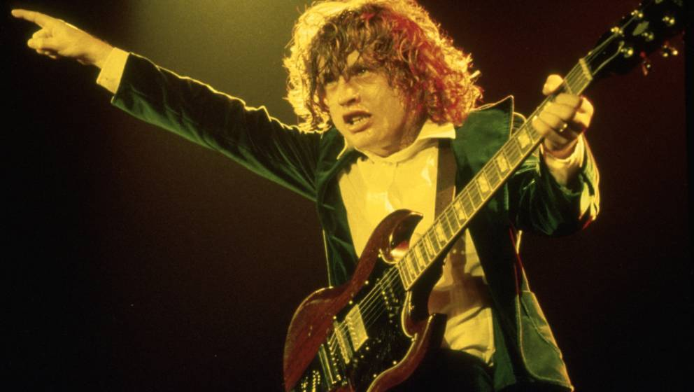 Angus Young of the band AC/DC performing live in 1980 © Michael Putland Credit all uses Retna UK