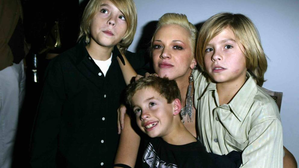 Cole Sprouse, Asia Argento, Dylan Sprouse and Jimmy Bennett (Photo by Jeff Vespa/WireImage)