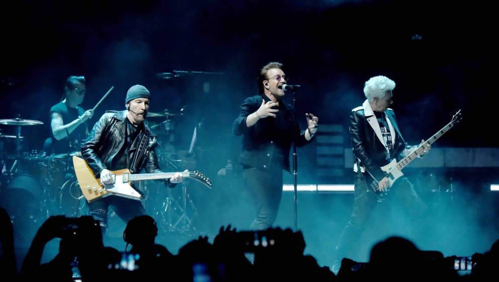 NEW YORK, NY - JULY 01:  Larry Mullen Jr., The Edge, Bono and Adam Clayton of U2 perform on stage during the 'eXPERIENCE &
