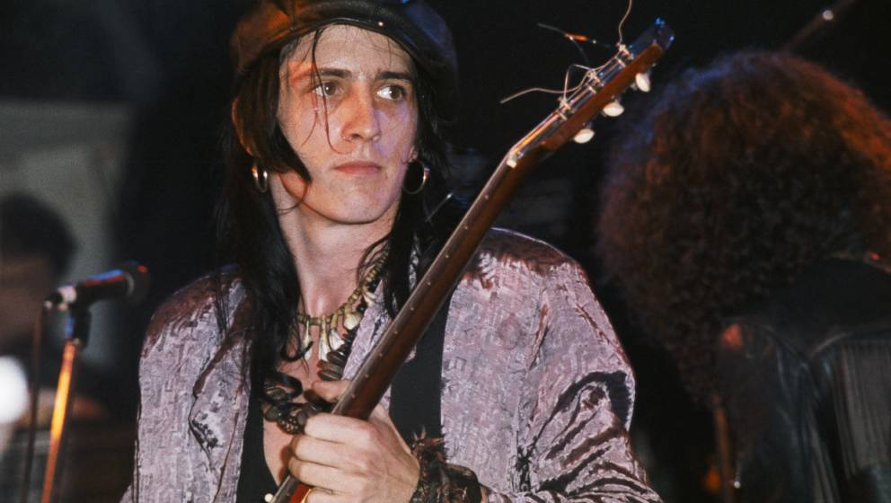 LONG BEACH - DECEMBER 21: Guitarist Izzy Stradlin of the rock group 'Guns n' Roses' performs at Fenders Ballroom  on December