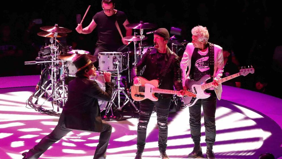 WASHINGTON, DC - JUNE 17:  (L to R) Bono, Larry Mullen, Jr., The Edge and Adam Clayton of U2 perform during the eXPERIENCE +