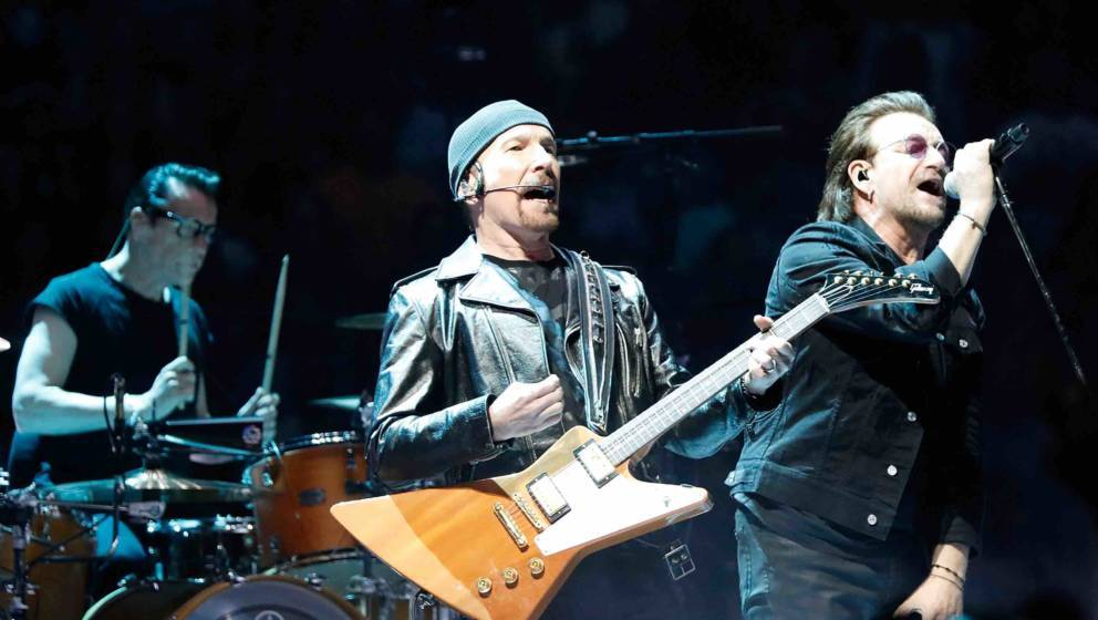 WASHINGTON, DC - JUNE 17:  (L to R)  Larry Mullen, Jr., The Edge and Bono of U2 perform during the eXPERIENCE + iNNOCENCE TOU