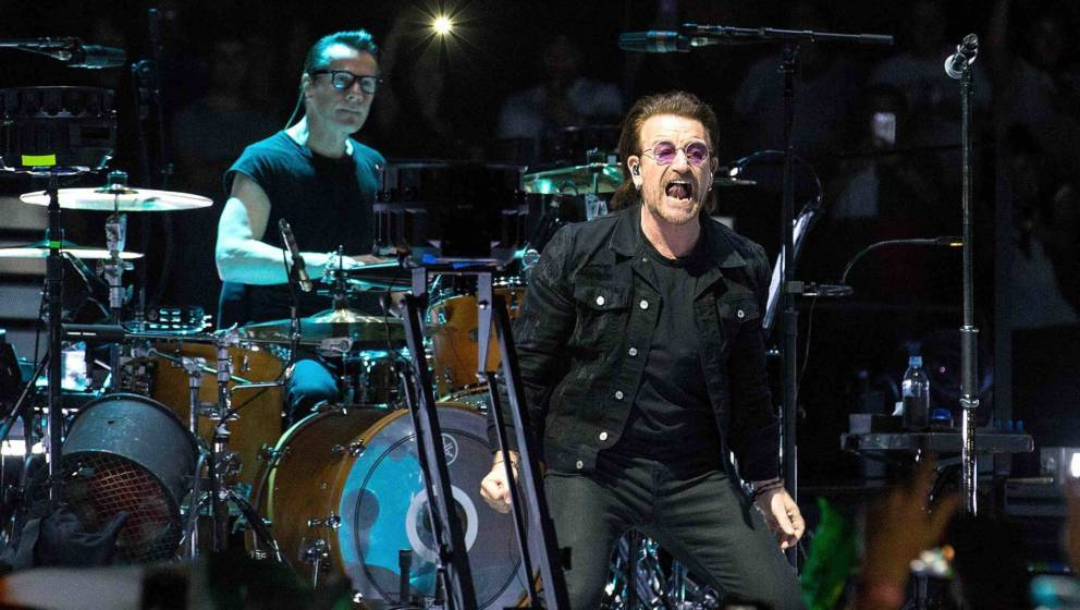 NEWARK, NJ - JUNE 29:  Larry Mullen, Jr. and Bono of U2 perform onstage during the eXPERIENCE + iNNOCENCE TOUR at Prudential