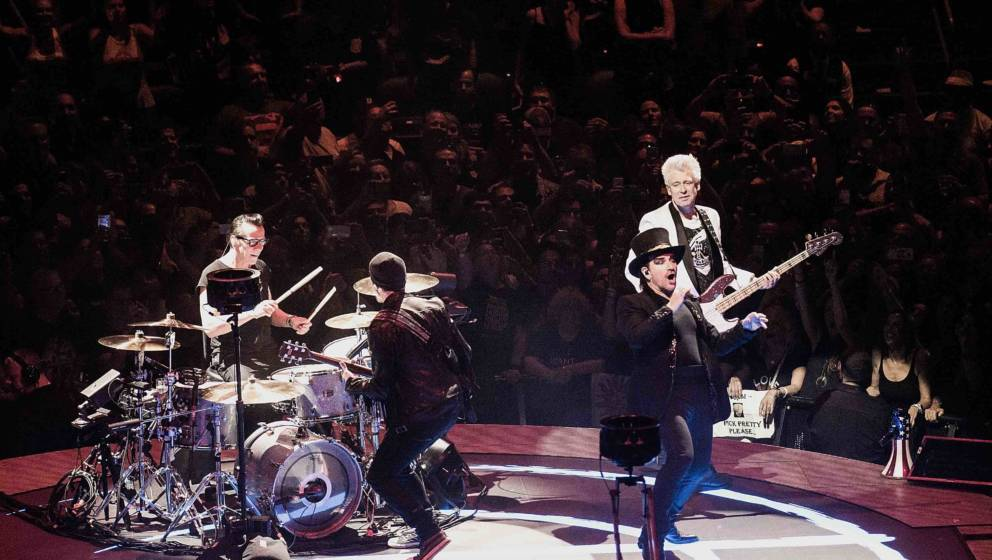 NEWARK, NJ - JUNE 29:  (L to R) The Edge, Larry Mullen, Jr., Bono, and Adam Clayton of U2 perform onstage during the eXPERIEN