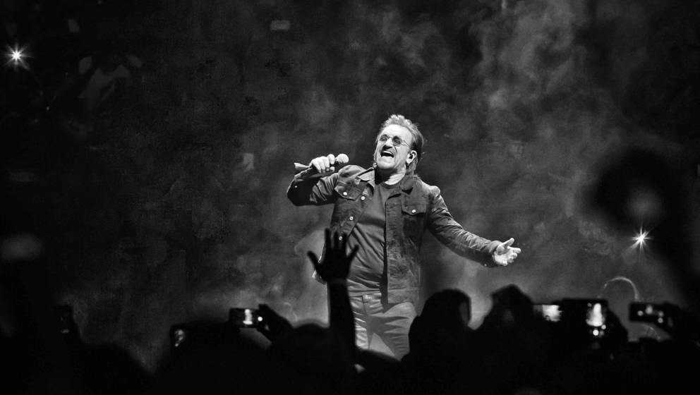 BERLIN, GERMANY - AUGUST 31: (EDITORS NOTE: Image has been converted to black and white.) Singer Bono of the Irish band U2 pe