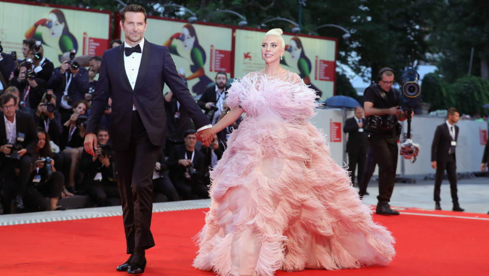 VENICE, ITALY - AUGUST 31:  Bradley Cooper (L) and Lady Gaga walk the red carpet ahead of the 'A Star Is Born' screening duri
