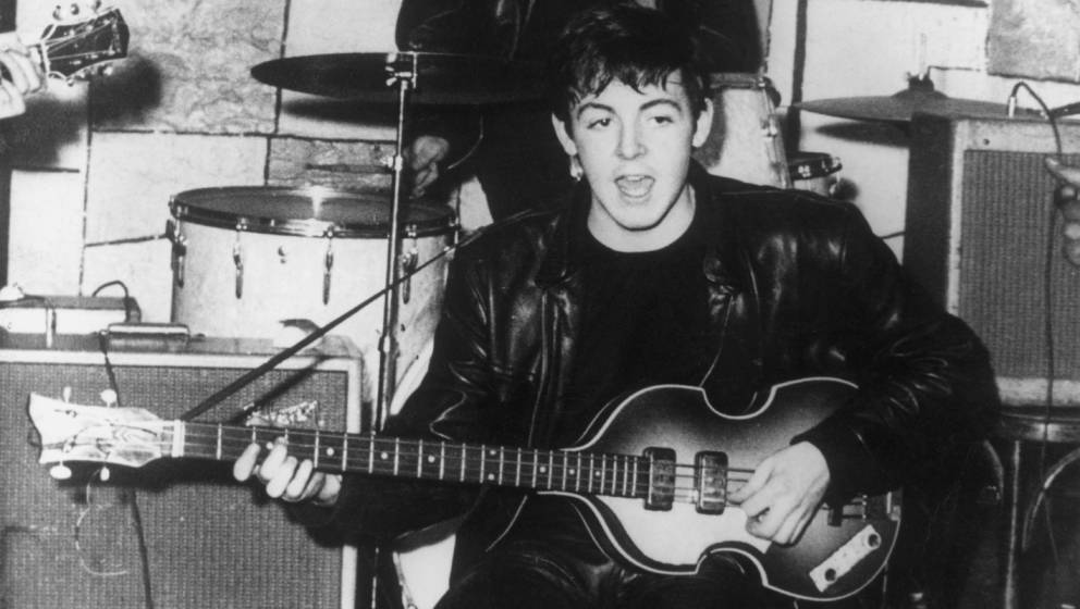 circa 1960:  Paul McCartney on stage at the Cavern nightclub in Liverpool during the early days of British beat group The Bea