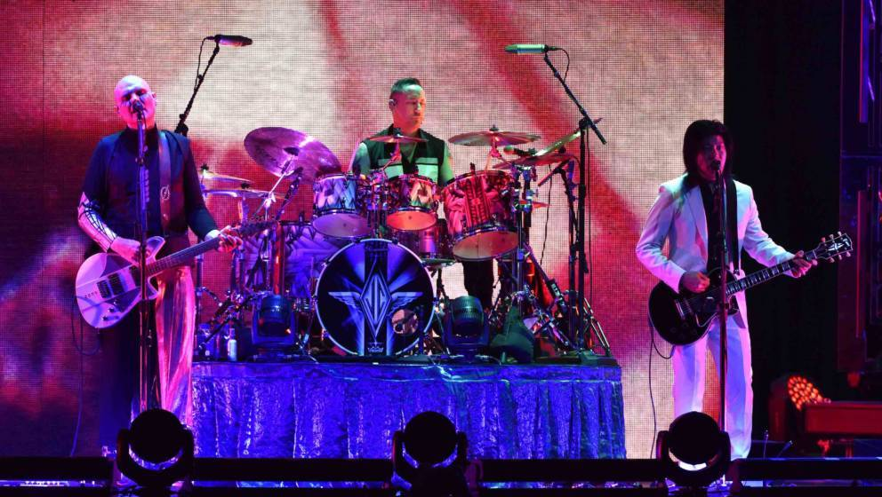 SACRAMENTO, CA - AUGUST 28:  (L-R) Billy Corgan, Jimmy Chamberlin, and James Iha of The Smashing Pumpkins perform during the