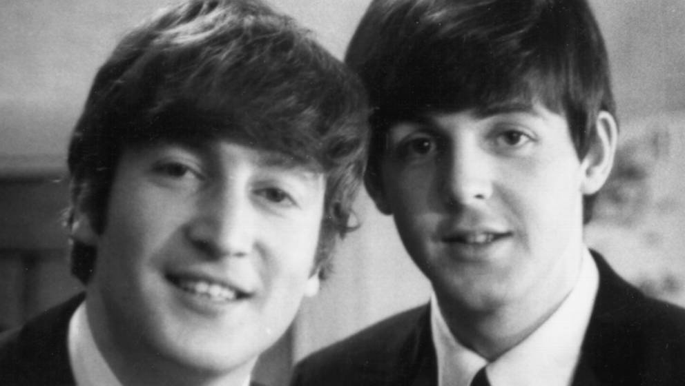 LONDON - 30th DECEMBER: Paul McCartney and John Lennon (1940-1980) from The Beatles posed backstage at the Finsbury Park Asto