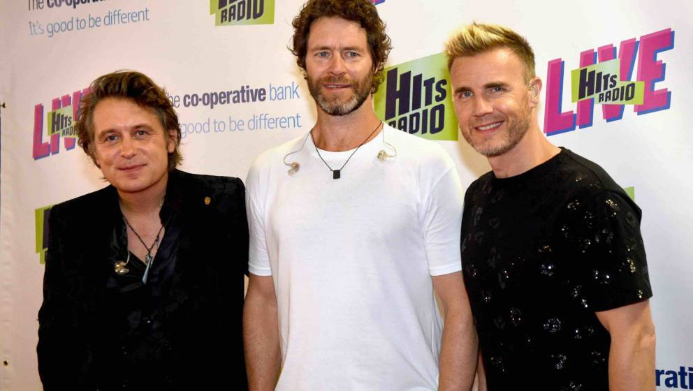 MANCHESTER, ENGLAND - JULY 14:  Mark Owen, Howard Donald and Gary Barlow of Take That during Hits Radio Live at Manchester Ar