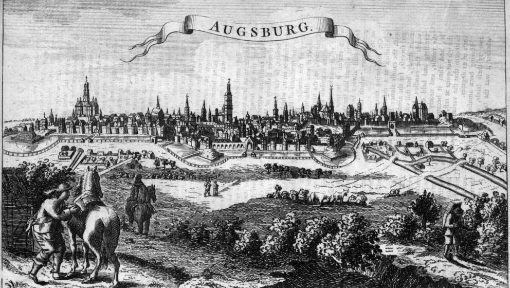 Circa 1650, Travellers approaching Augsburg in Germany through fields surrounding the walled city (Photo by Hulton Archive/Ge
