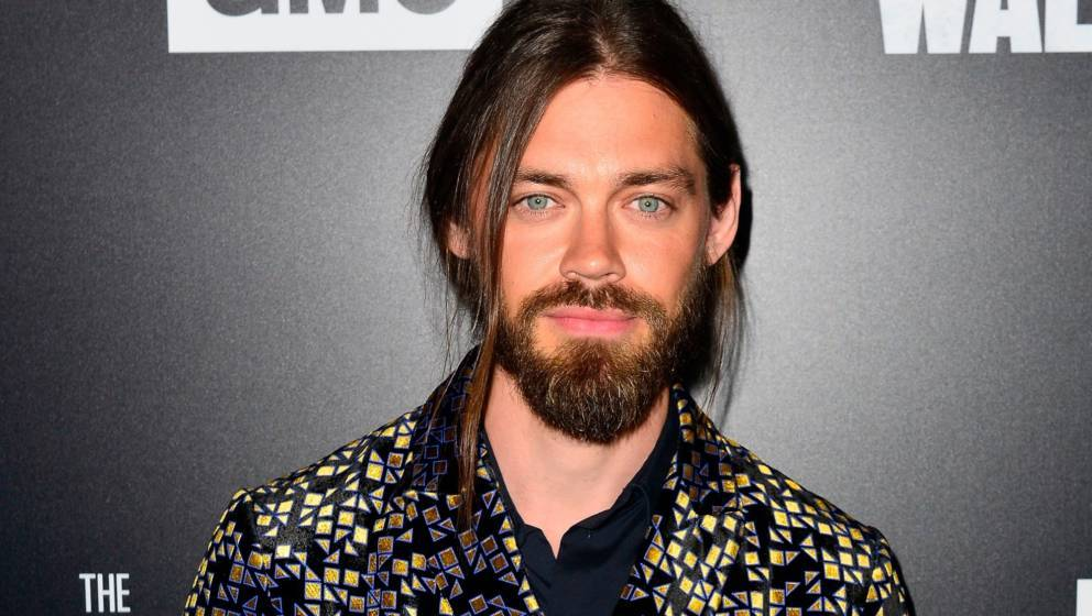 LOS ANGELES, CA - SEPTEMBER 27:  Tom Payne arrives at the Premiere Of AMC's 'The Walking Dead' Season 9 at the DGA Theater on