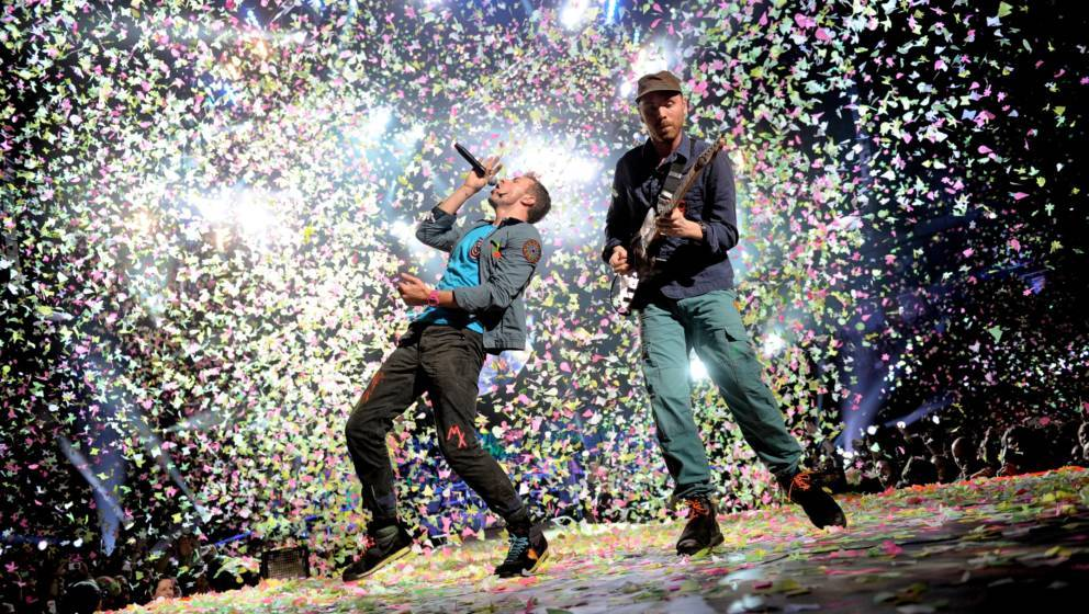 COLOGNE, GERMANY - DECEMBER 15: Chris Martin and Jonny Buckland (L-R) of Coldplay perform onstage at the Lanxess-Arena on Dec