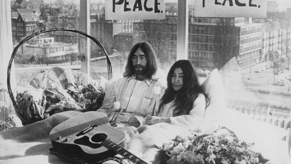 Beatle John Lennon (1940  1980) and his wife of a week Yoko Ono in their bed in the Presidential Suite of the Hilton Hotel,