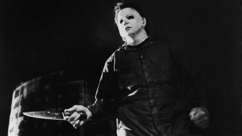Actor Tony Moran, as masked kiler Michael Myers, wields a knife in a still from the horror film, 'Halloween,' directed by Joh
