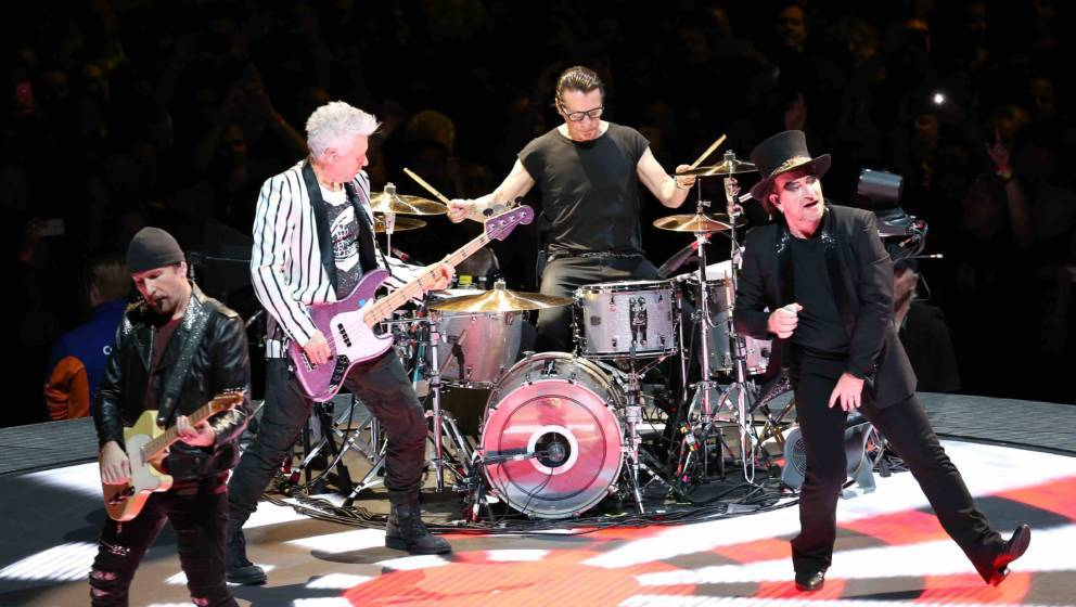 LONDON, ENGLAND - OCTOBER 23: The Edge, Adam Clayton, Larry Mullen Jr  and Bono of U2 performs live on stage during the 'Inno