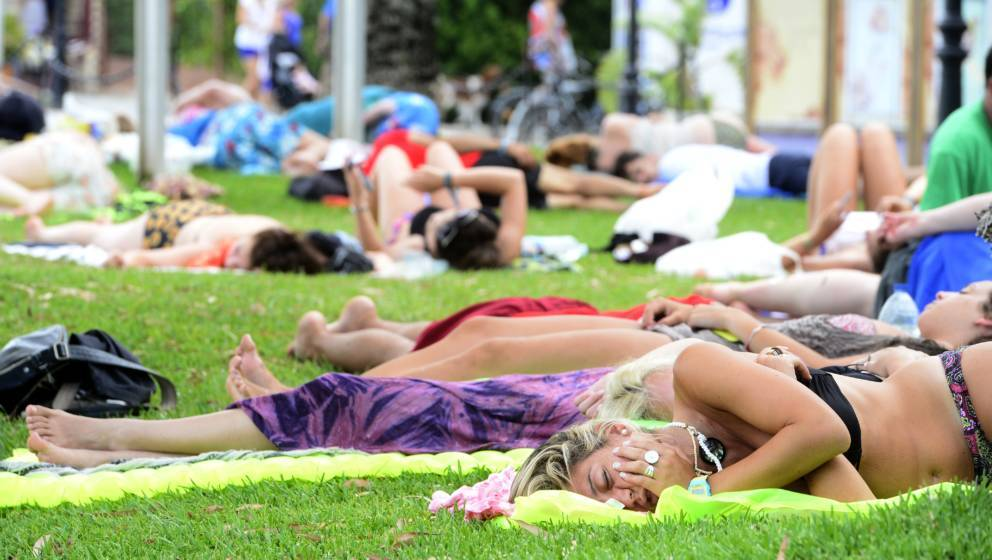 Revellers sleep on a beach during the Benicassim International Festival (FIB) in Benicassim, Castellon province, on July 19,
