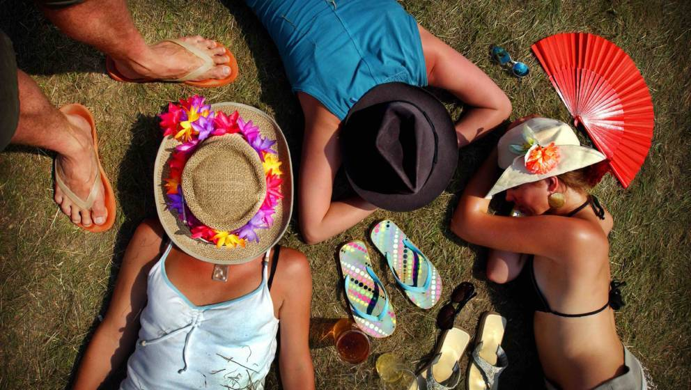 Festival goers enjoying a snooze in the sun, The Big Chill festival, UK 2004