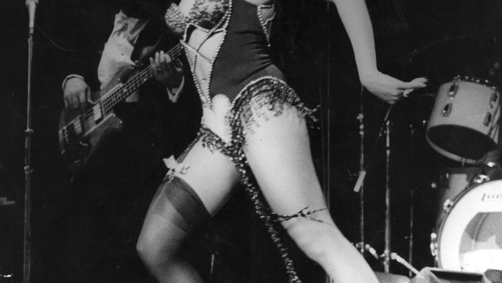 American pop singer Tina Turner performing on stage at the Hammersmith Odeon, her first solo concert in London since splittin
