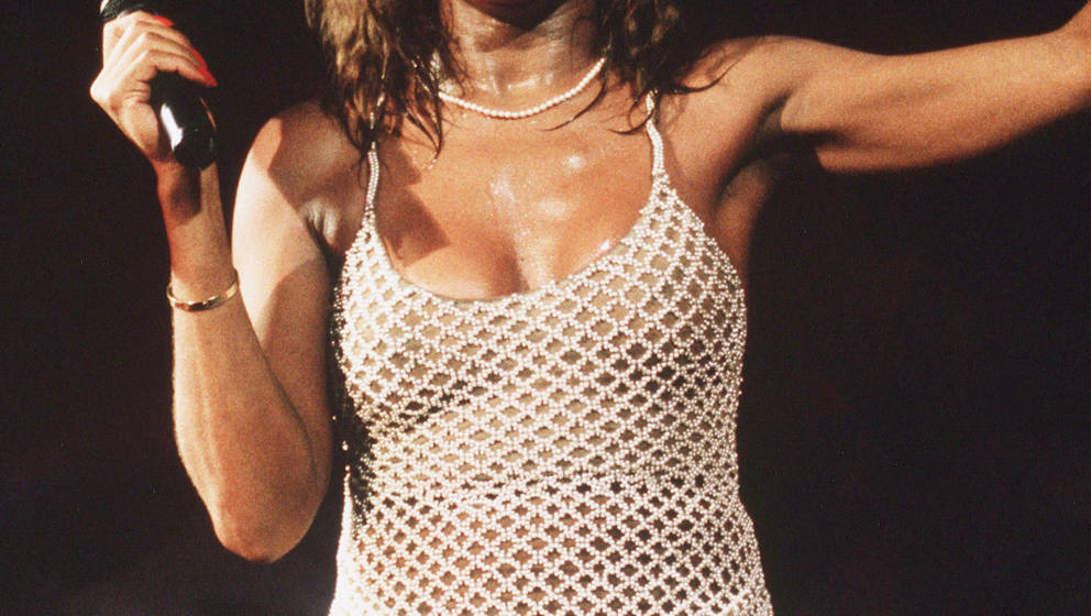 LONDON - 1990: Singer Tina Turner performs live on stage at Wembley Stadium. (Photo by Dave Hogan/Getty Images)
