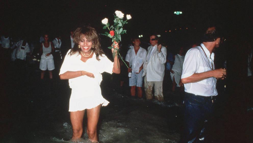 RIO DE JANEIRO, BRAZIL - 1988: Singer Tina Turner in the sea on New Years Eve in Rio de Janeiro, Brazil. (Photo by Dave Hogan