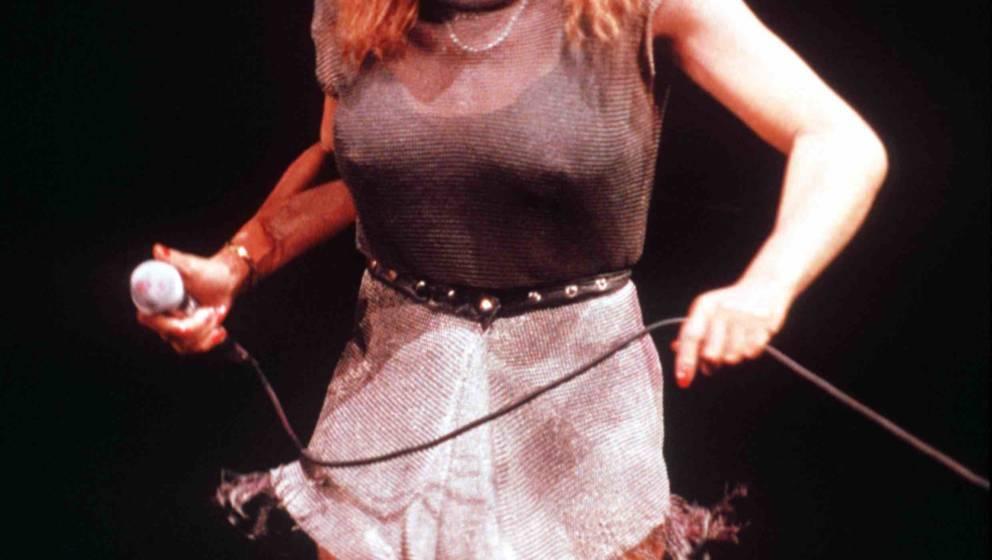 Tina Turner performing on stage, London, United Kingdom, 1990. (Photo by Ian Dickson/Redferns)