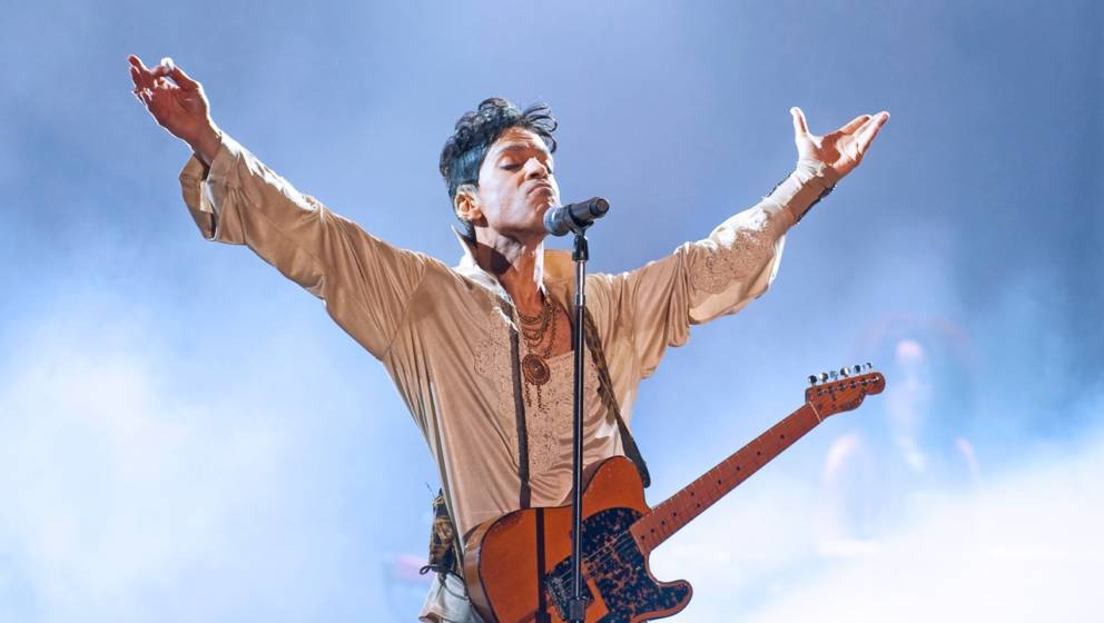 PADDOCK WOOD, UNITED KINGDOM - JULY 03: Prince headlines the main stage on the last day of Hop Farm Festival on July 3, 2011