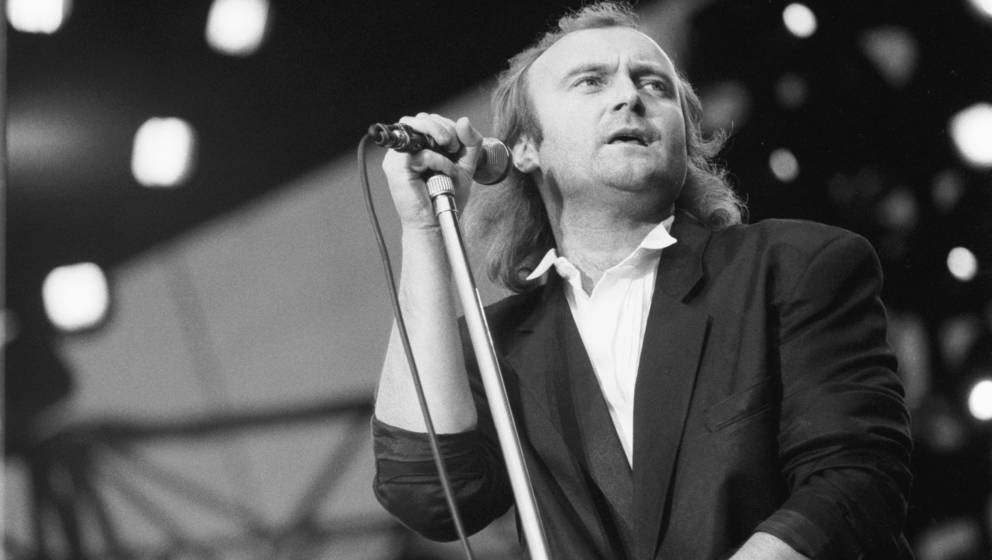 ROTTERDAM, NETHERLANDS - 11th JUNE: Phil Collins  performs live on stage with Genesis at the Feijenoord Stadium in Rotterdam,