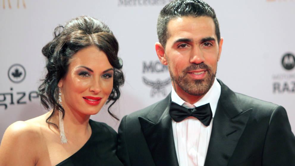 (FILES) In this file photo taken on November 10, 2011 German-Tunisian rap singer Bushido (R) poses with his partner Anna Mari
