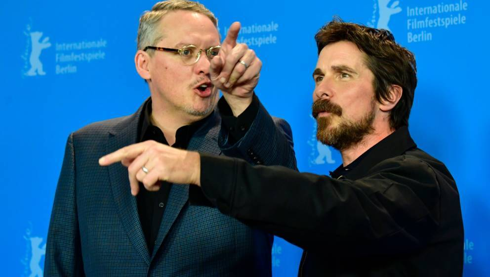 British-US actor Christian Bale (R) and US director and screenwriter Adam McKay pose during a photocall for the film 'Vice' a