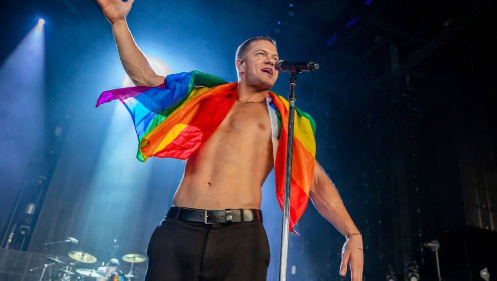 CLARKSTON, MI - JUNE 21:  Dan Reynolds of Imagine Dragons holds a gay pride flag during their Evolve World Tour 2018 at DTE E