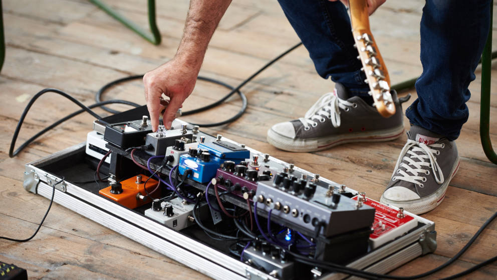 Detail of a guitarist standing alongside a selection of effects pedal, taken on October 6, 2015. (Photo by Joby Sessions/Guit