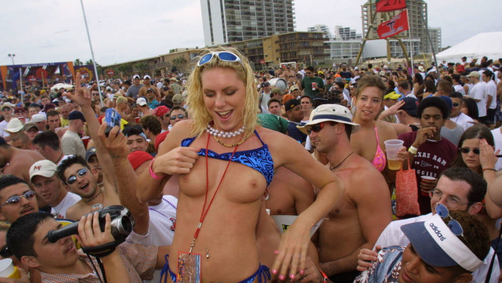 386746 17: A female student shows her breasts on the beach at South Padre Island, Texas March 16, 2001 during the annual rite