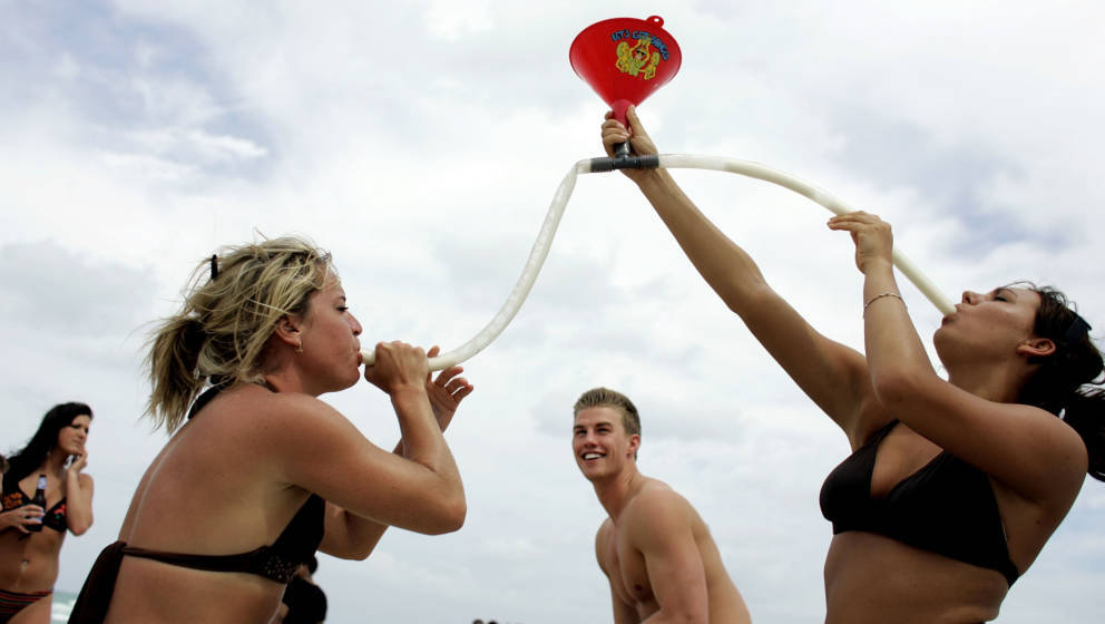 MIAMI BEACH- MARCH 14:  Megan Jump (L) and Jenna Haring ,on spring break from Ball State University, use a funnel to drink be