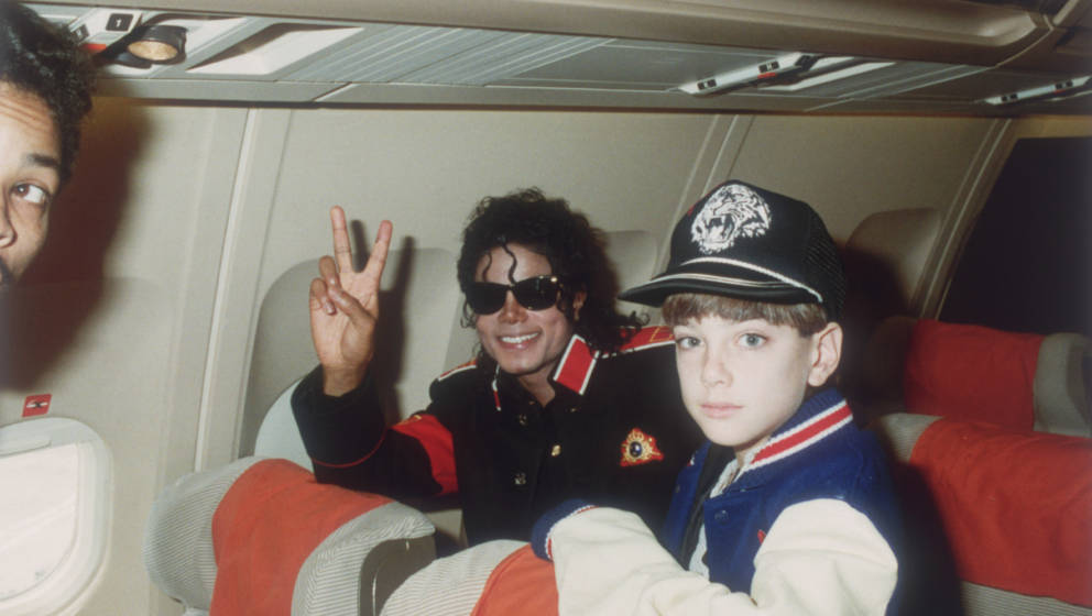 UNSPECIFIED - JULY 11: Michael Jackson with 10 year old Jimmy Safechuck on the tour plane on 11th of July 1988. (Photo by Dav