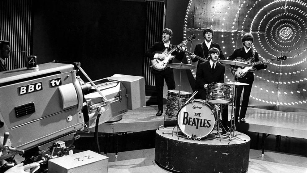 UNITED KINGDOM - JUNE 16:  TOP OF THE POPS  Photo of BEATLES, Back row l-r. John Lennon, Paul McCartney, George Harrison. Fro