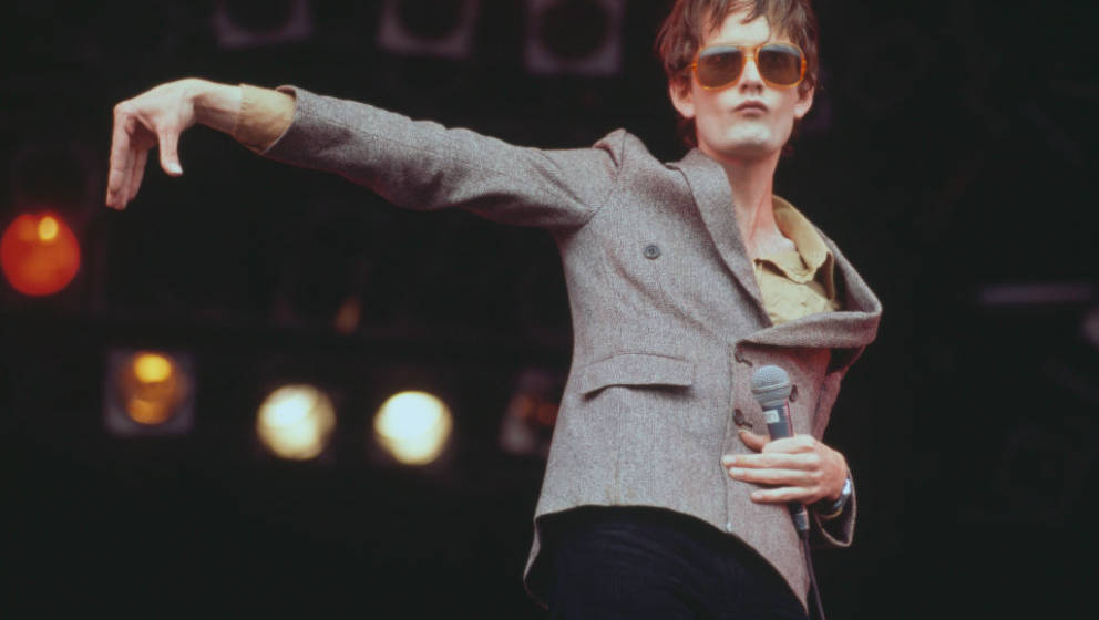 Jarvis Cocker, lead singer of English rock band Pulp, performs live on the NME stage at the Glastonbury Festival near Pilton,