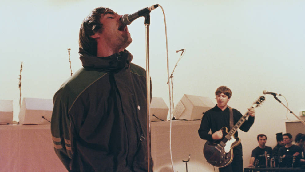 Singer Liam Gallagher (left) and his brother, guitarist Noel Gallagher, performing with British rock band Oasis on Channel 4'