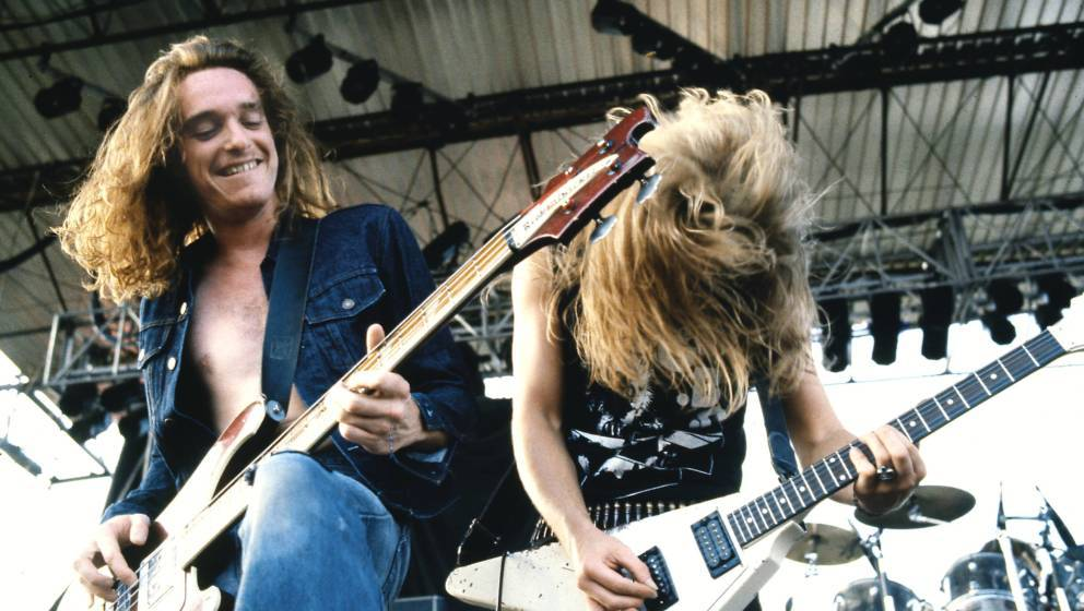UNITED KINGDOM - JANUARY 01:  Photo of METALLICA and Cliff BURTON and James HETFIELD; Cliff Burton (playing Rickenbacker bass