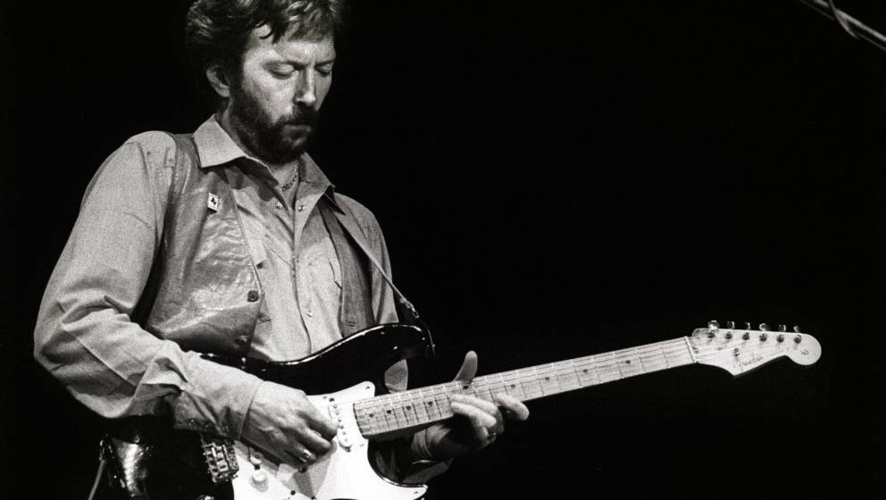 Eric Clapton performs on stage at Ahoy, Rotterdam, Netherlands, 23rd April 1983. He plays a Fender Stratocaster guitar. (Phot