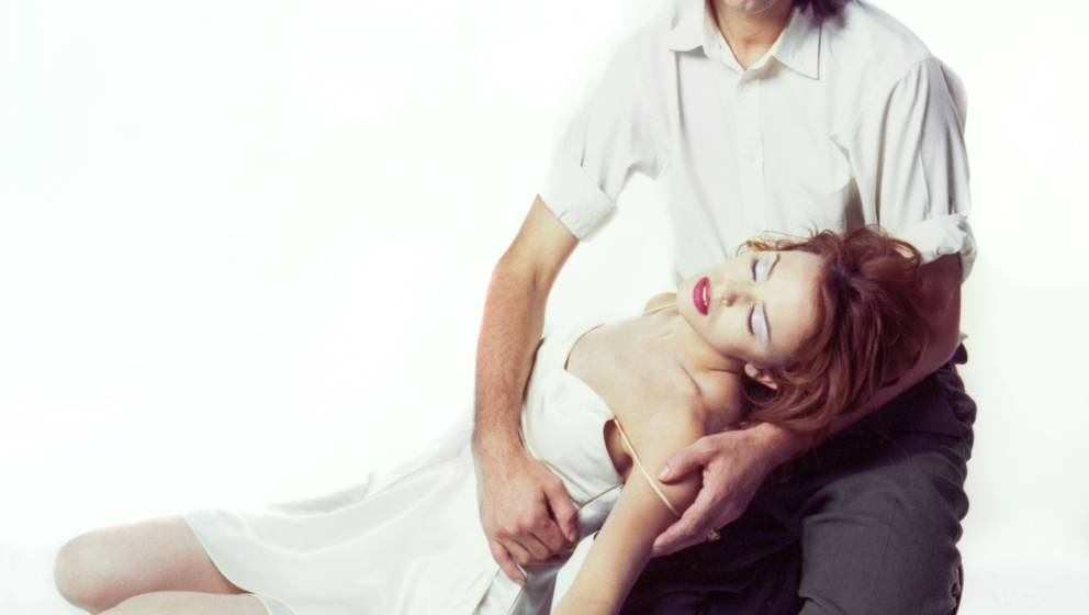 Studio portrait of Nick Cave and Kylie Minogue to promote their duet 'Where the Wild Roses Grow' from the album 'Murder Balla